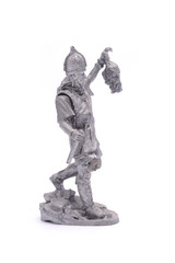 tin soldier medieval knight with severed head isolated on white