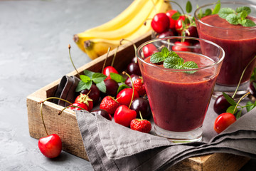 smoothie with cherry and banana, strawberries