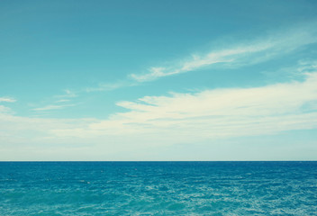 Vintage sea and blue cloudy sky background