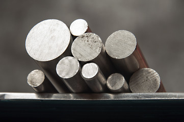 stainless steel rods on a welding table