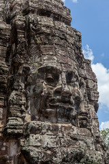 Ruin bayon stone face at gateway of Angkor Wat, Siem Reap, Cambo
