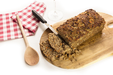Freshly cooked and cut meatloaf with knife