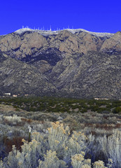 Sandia Peak and Sandia Crest just after sunset with ice and snow on summit, a popular mountain to hike and climb in New Mexico, USA, desert, arid, dry, four corners USA, landscape,