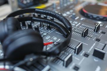 DJ Mixer with headphones.