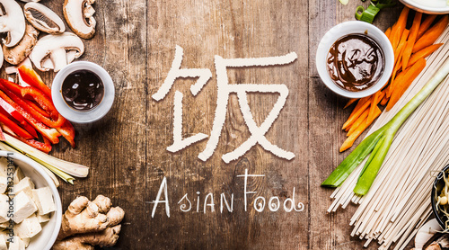 Asian food with various vegetables cooking ingredients on wooden asian food with various vegetables cooking ingredients on wooden background with chinese hieroglyph of food forumfinder Images