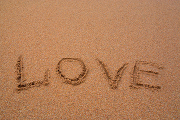 "written words "" love "" on sand of beach"