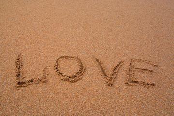 "written words "" love "" on sand of beach"