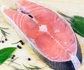 fresh salmon slices on wood background.