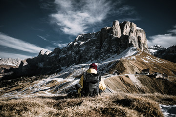 Person sitting in the mountains