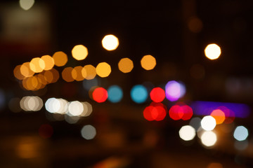 Abstract urban colorful night light bokeh, defocused background.