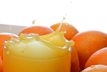 Glass of Orange juice splashing juice