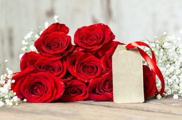 background of gift paper and red roses.