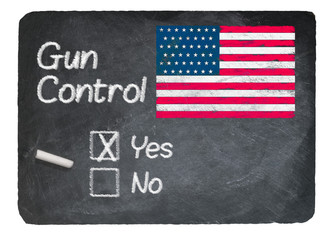 Gun Control choice using chalk on slate blackboard