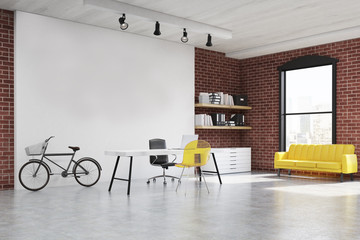 Home office with yellow sofa