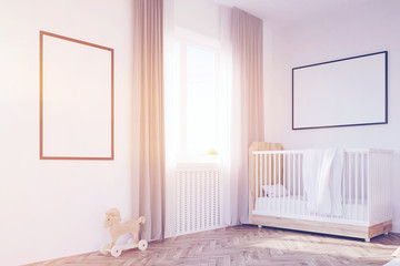 Corner of baby's room with a crib, toned