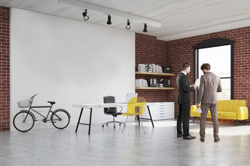 Two men in a start up office