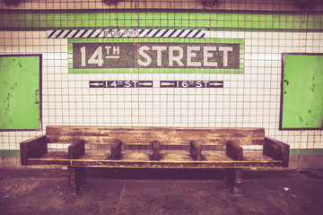 Retro style image of Bench at New York City subway station with vintage tile wall