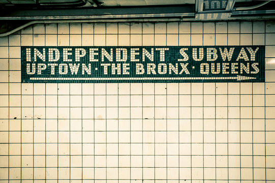 Retro tiled wall in New York City subway station with vintage filter effect