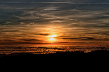 Amazing evening with sunset in Eagle mountains. Beautiful sunset within inversion