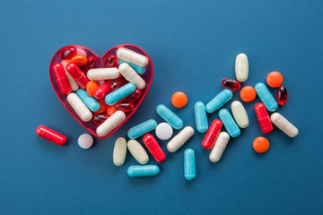 Pills in a heart shape container
