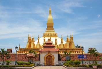 The golden pagoda wat Phra That Luang in Vientiane. Buddhist temple. Famous tourist destination in Asia. (Laos travel landmark)
