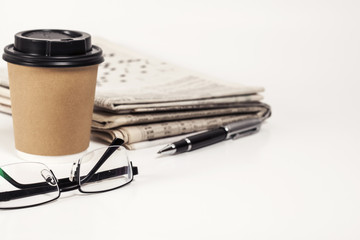 Coffee with newspaper on white background