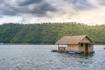 Raft house on green water in natural with soft light.