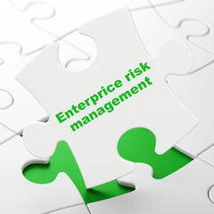 Business concept: Enterprice Risk Management on puzzle background
