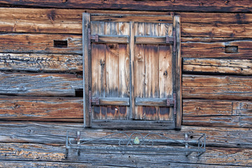 Old wood  mountain cabin hut window
