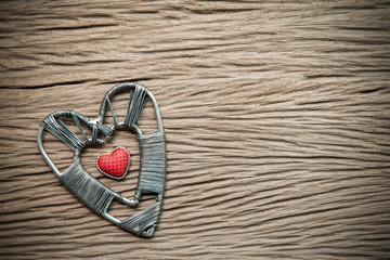 Valentines day background with hearts on wood background.