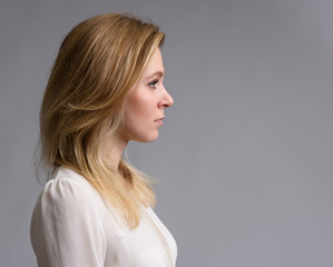 profile portrait of a beautiful blonde woman