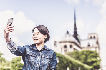Young Chinese Female Enjoying Her Trip To Paris
