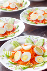 Fresh vegetable salad  and boiled egg in a bowl.
