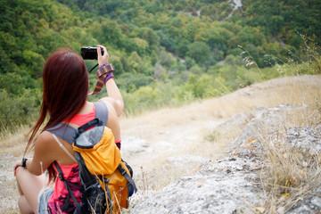Brunette photographed scenic mountain landscape