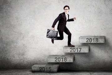 Male entrepreneur steps on number 2017