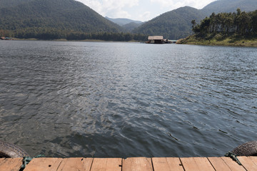 Wood Floor with Beautiful landscape of Lake in the mountains
