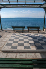 Oversized chess board on water front