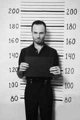Portrait of criminal man on detective party