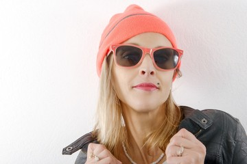 pretty blonde woman with winter hat and sunglasses
