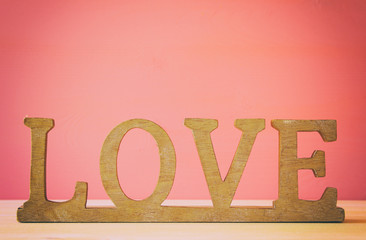 word LOVE from wooden letters and heart