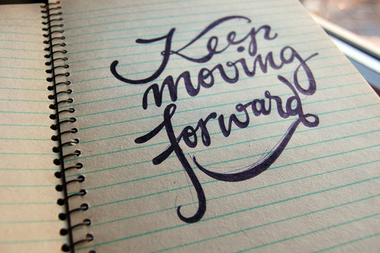 Keep Moving Forward calligraphic background
