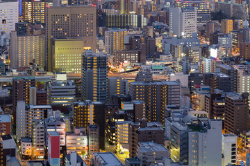 Osaka business district, city downtown aerial view at night, Japan