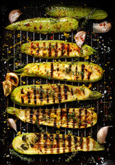 Grilled zucchini with addition of thyme, lemon zest and garlic, top view