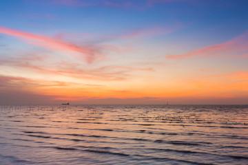 Poster Crimson Beauty of sunset over seacoast skyline, natural landscape background