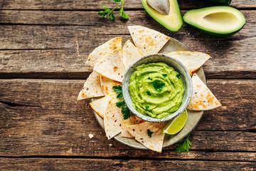 Nachos on plate and avocado sauce