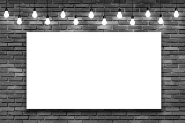 Blank white frame on brick wall with bulb lights lamp. nice brick show room with spotlights.