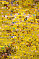 Vintage wall mosaic with bright yellow rough cut tiles