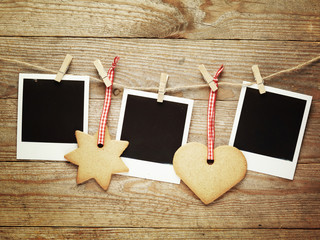 Vintage photo frames decorated for Christmas on the wooden board
