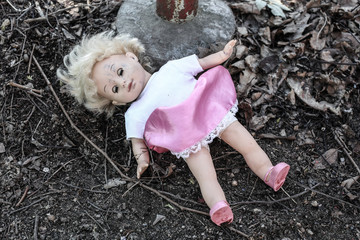 dirty old abandoned doll