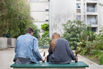 alcoholism, young people drinking beer on the bench
